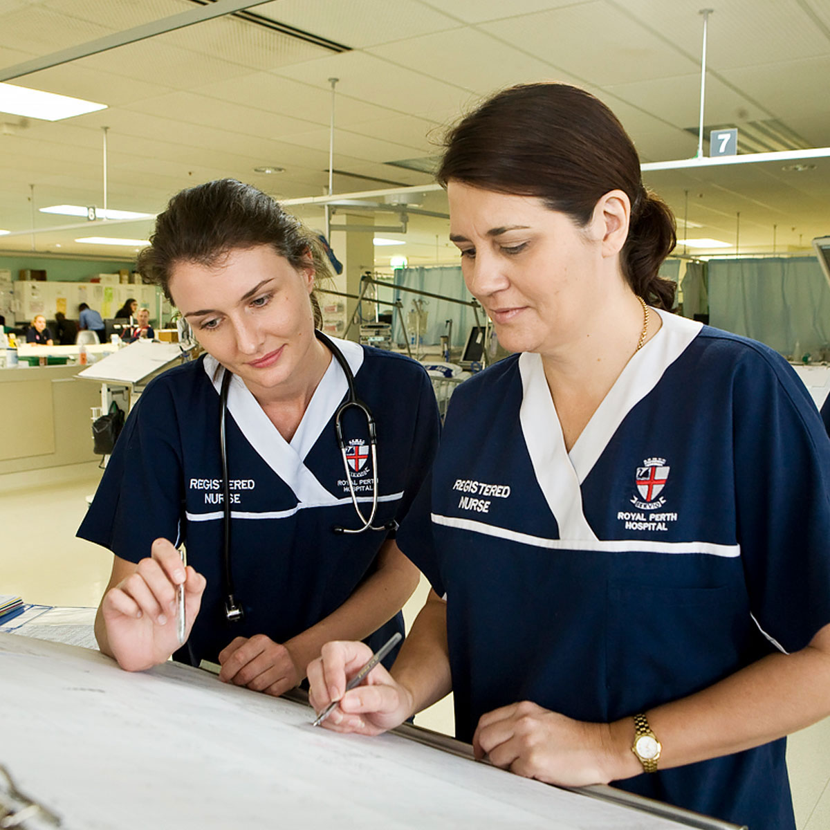 Two nurses looking at notes